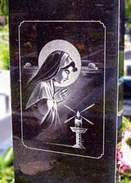 художественное оформление на ритуальный памятник из камня