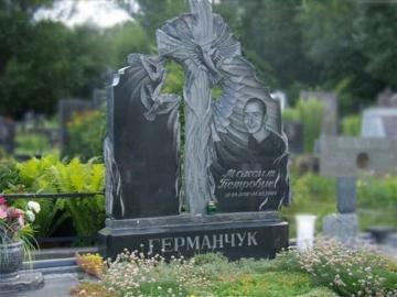 одиночный  элитный памятник из камня на могилу